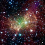 """Looking like a piece of cosmic workout equipment, the """"Dumbbell Nebula,"""" also known as M27, pumps out infrared light in this image from NASA's Spitzer Space Telescope. Discovered in 1764, Charles Messier included it as the 27th member of his famous"""